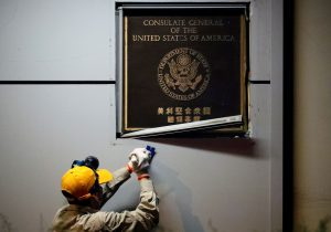 A man works to remove the US Consulate plaque at the US Consulate General in Chengdu, Sichuan province, China, 26 July 2020 (Photo: Reuters/Thomas Peter).