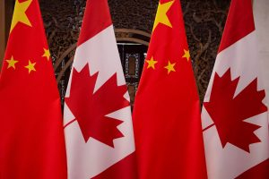 Picture of Canadian and Chinese flags at Diaoyutai State Guesthouse, 5 December 2017. (Photo: Pool/Fred Dufour via Reuters).