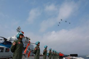 Navy personnel of Chinese People's Liberation Army (PLA) Navy take part in a military display in the South China Sea, 12 April 2018 (Photo: Reuters/Stringer).