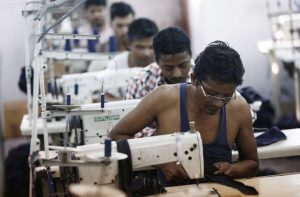 Employees sew clothes at a garment factory in New Delhi, India, 29 September 2014 (Photo: Reuters/Adnan Abidi).