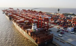 An aerial view of containers piled up at Yangshan Port, a deep water port for container ships, waiting to be stored and exported, Shanghai, 20 March 2020 (Reuters).