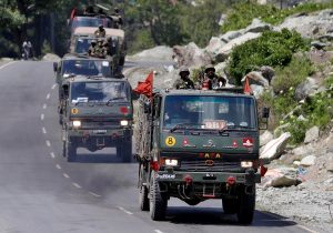 An Indian Army convoy moves along a highway leading to Ladakh, at Gagangeer in Kashmir's Ganderbal district 18 June 2020 (Reuters/Danish Ismail/File Photo).