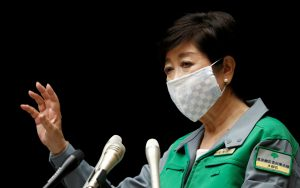 Tokyo Governor Yuriko Koike gestures as she attends a joint news conference with Japan's Economy Minister Yasutoshi Nishimura and other panel members after their talks on the latest situation of the coronavirus disease (COVID-19) outbreak, in Tokyo, Japan, 10 July, 2020. (Reuters/Issei Kato).