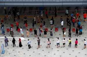 Voters practice social distancing while queuing at a polling station during Singapore's general election amid the COVID-19 outbreak, 10 July 2020 (Photo: Reuters/Edgar Su).