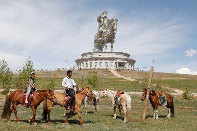 People ride horses near the Genghis Khan Statue Complex, east of Ulaanbaatar, Mongolia (Photo: Reuters/B Rentsendorj).