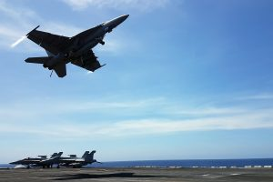 An F18 fighter takes off from the deck of the USS Theodore Roosevelt while transiting the South China Sea, 10 April 2018 (Photo: Reuters/Karen Lema).