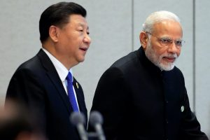 China's President Xi Jinping and India's Prime Minister Narendra Modi arrive for a signing ceremony during Shanghai Cooperation Organization (SCO) summit in Qingdao, Shandong Province, China, 10 June, 2018 (Reuters/Aly Song).