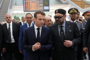 French President Emmanuel Macron and Moroccan King Mohammed VI speak as they attend the inauguration of a high-speed line at Rabat train station, in Rabat, Morocco November 15, 2018 (Christophe Archambault/Pool via Reuters)