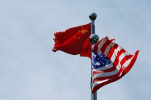 Chinese and US flags flutter near The Bund, Shanghai, China, 30 July 2019 (Photo: Reuters/Aly Song).