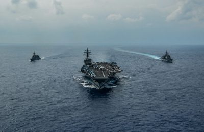 Hand out file photo dated 27 October, 2019 of the aircraft carrier USS Ronald Reagan (CVN 76), the Ticonderoga-class guided-missile cruiser USS Chancellorsville (CG 62) and the Japan Maritime Self-Defense Force Akizuki-class destroyer JS Fuyuzuki (DD 118) are underway in formation while conducting a bilateral exercise in the Philippine Sea. An unknown number of sailors onboard the Nimitz class aircraft carrier USS Ronald Reagan, which forward-deployed in Japan and presently pier-side there, have tested positive for the COVID-19 novel coronavirus. This comes just a day after the U.S. Navy announced it had quarantined the entire crew of another aircraft carrier, the USS Theodore Roosevelt, on their ship in port in Guam after a number of sailors contracted the virus (Photo: Reuters/Codie L. Soule).