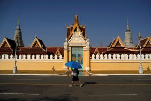 A woman walks outside the Royal Palace which has being closed for visitors as precaution against the coronavirus outbreak in Phnom Penh, Cambodia, 19 March 2020 (Photo: Reuters/Cindy Liu).
